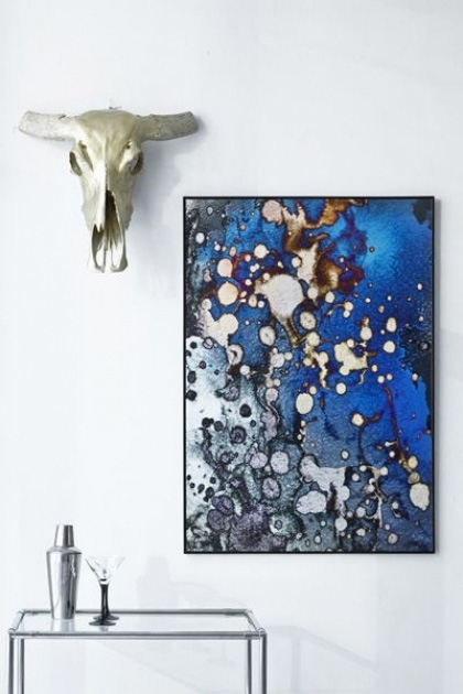 lifestyle image of Unframed Underwatery Art Print hung on white wall with white skull ornament above black drinks trolley
