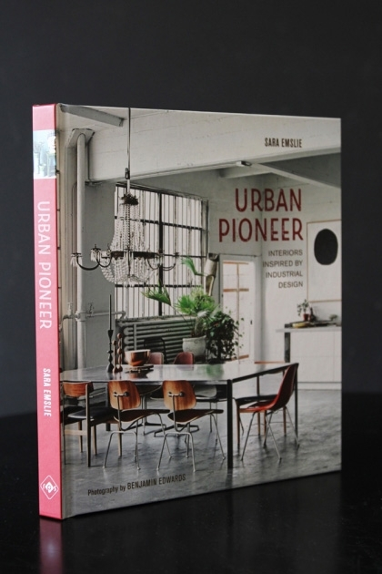 lifestyle image of Urban Pioneer: Interiors inspired by industrial design on black table with dark wall background