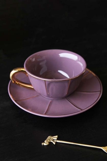 lifestyle image of Vintage Style Tea Cup & Saucer - Purple with gold spoon on black table