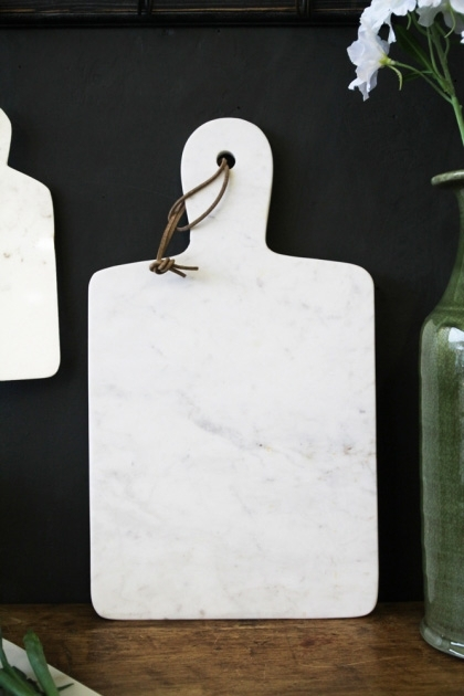Lifestyle image of the White Marble Paddle Chopping Board