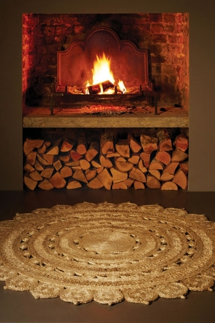 lifestyle image of Zira Circular Jute Rug - 2 Colours with fireplace