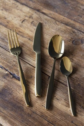 lifestyle image of 16 Piece Gold Cutlery Set on wooden table
