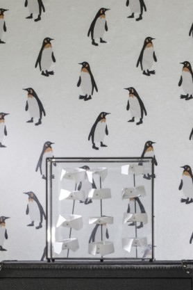 detail image of Andrew Martin Emporor Wallpaper - 4 Colours Available with paper collar ornament on black desk