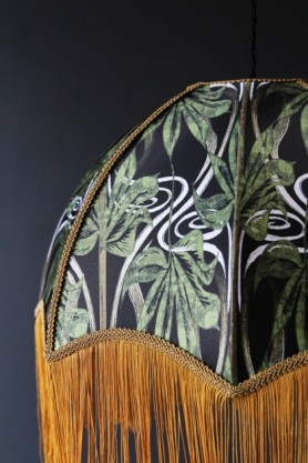 detail image of Anna Hayman Designs DecoFabulous Green Dianne Lamp Shade with dark wall background green pattern and gold fringe