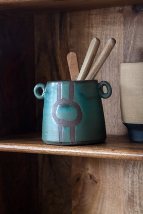 Lifestyle image of the Ocean Blue Green Terracotta Pot With Abstract Design & Little Handles