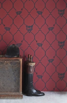 Close-up lifestyle image of Barneby Gates Wallpaper - Fox & Hen - Brick with wellington boots and old wooden box with horse riding helmet on top