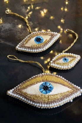 Sparkly lifestyle image of the Set Of 3 Beaded Eyes Hanging Decorations