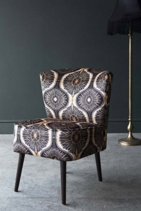 lifestyle image of Bespoke Hayworth 1950'S Cocktail Chair with black floor lamp and grey flooring with dark wall background
