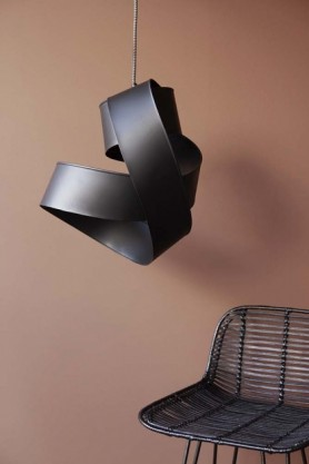 Lifestyle image of Black Twisted Ribbon Ceiling Light above rattan bar stool and mauve wall background