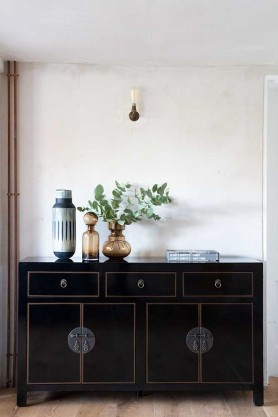 Lifestyle image of the Oriental Gloss Black Sideboard