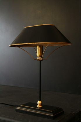 lifestyle image of Black & Gold Table Lamp on black table with dark wall background