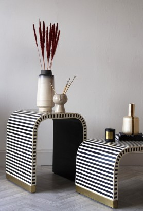 Lifestyle image of the Monochrome Stripe Bone Inlay Side Table with the matching Coffee Table in the foreground