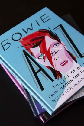 lifestyle image of Bowie A To Z The Life Of An Icon From Aladdin Sane To Ziggy Stardust on black table
