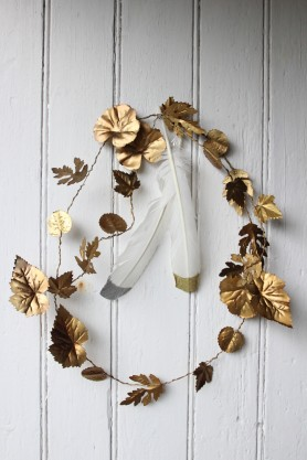 Image of the Metal Leaf Garland Decoration hanging on a wall