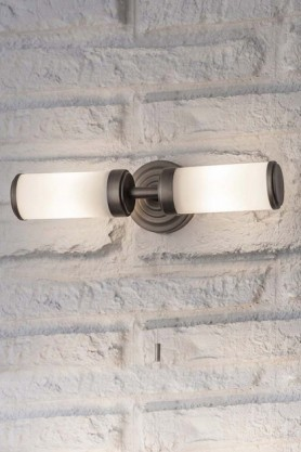lifestyle image of Bronze Beaufort Bathroom Wall Light on white brick wall background