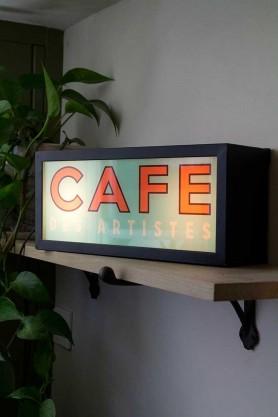 Lifestyle image of the Cafe des Artistes Light Box on a shelf