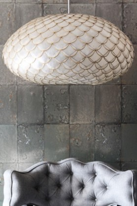 lifestyle image of Capiz Shell Ceiling Light above Cloud Herringbone Tweed Chair - Garson Grey with Cole & Son Mariinsky - Antique Mirror Wallpaper background