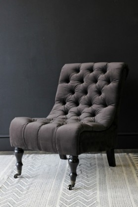 Charcoal Velvet Occasional Chair on dark background lifestyle image