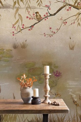 Lifestyle image of the Chinoiserie Wallpaper Mural - Lotus Clow with dining table with candlestick and vase with orange flowers in