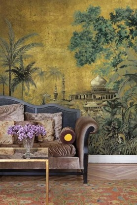 Lifestyle image of the Chinoiserie Wallpaper Mural - Taj Mahal Chai with velvet sofa and coffee ytable with purple flowers in vcase on top and patterned rug on wooden flooring