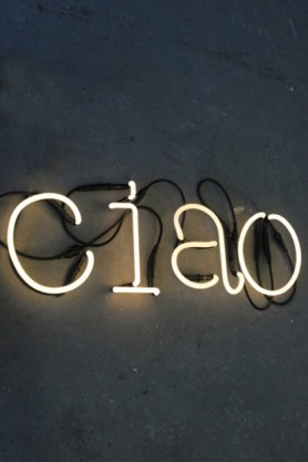 CIAO LED Neon Light lit up on dark wall background lifestyle image