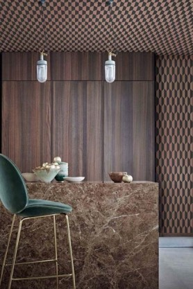 lifestyle image of Cole & Son Icons Collection - Petite Tile Wallpaper - 2 Colours Available with marble effect counter and green bar stool and white ceiling lights