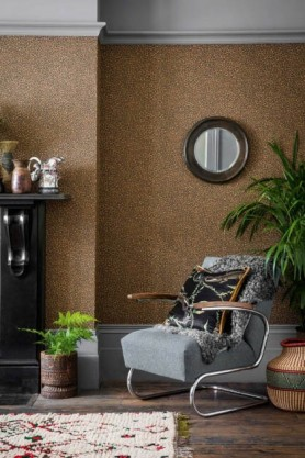 lifestyle image of Cole & Son - The Ardmore Collection - Senzo in living room with grey arm chair, hanging mirror and large plant with patterned rug on floor