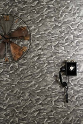 lifestyle image of Cole & Son Whimsical Collection - Columbus Wallpaper - 2 Colours Available with black wall phone and rusty propeller ornament on wall