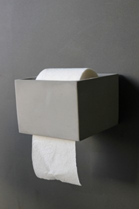 Concrete Toilet Roll Holder on grey wall lifestyle image