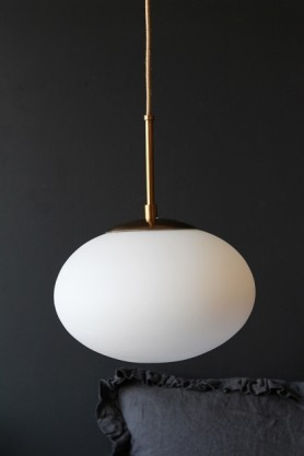 Close-up lifestyle image of the Cruz Opal Pendant Light