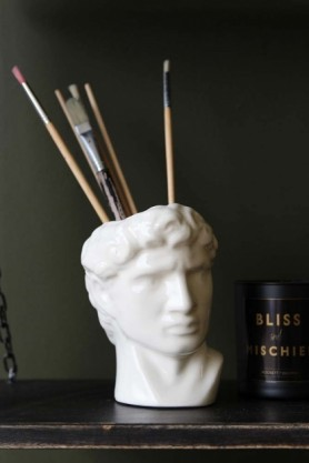 lifestyle image of David Display Vase with paintbrushes in and Rockett St George Scented Candles - Bliss And Mischief on black table and dark green wall background