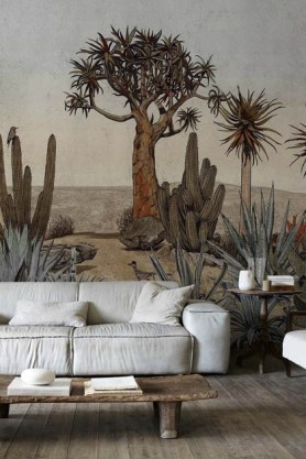 Lifestyle image of the Desert Landscape Wallpaper Mural - Meiji Maca with plae grey sofa with wooden coffee table in front and wooden side table with white vases on top at the side on wooden flooring