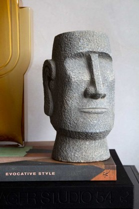 Image of the front of the Decorative Concrete Head sitting on a book