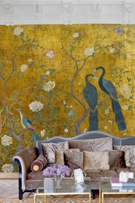 lifestyle image of Edo Mural Design Wallpaper Panel - Gold with sofa topped with beige and nude coloured cushions and glass coffee table