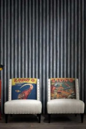 lifestyle image of Andrew Martin Engineer Collection - Palmer Corrugated Iron Wallpaper - 2 Colours Available behind two white armchairs