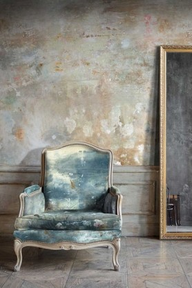 lifestyle image of Feathr Oh La La Wallpaper by Kiki Slaughter - Sand with distressed blue armchair and large wooden frame