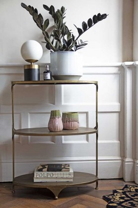Lifestyle image of the Three-Tier Brass Shelving Unit