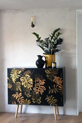 Lifestyle image of the Hand-Painted Tropical Leaf Sideboard