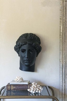 Front on lifestyle image of the Aelina Black Ladies Head Wall Display Ornament