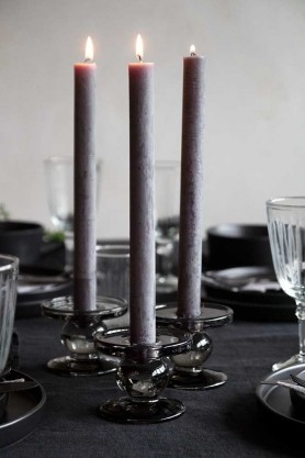 Image of the Dark Grey Rustic Dinner Candle on a table and lit