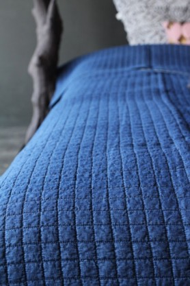 detail image of Griselle Indigo Blue Bedspread with dark wall background