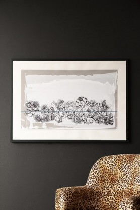 Lifestyle image of the Hand Screen Printed Floral Gladstone Grey Landscape Artwork By Lizzie Coles hanging on dark grey wall above Rockett St George Leopard Love Armchair