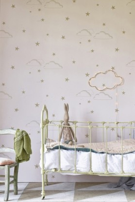 lifestyle image of Hibou Home Starry Sky Children's Wallpaper - 2 Colours Available with green metal bed and green chair with green blanket on