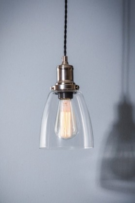 lifestyle image of Hoxton Domed Glass Pendant Ceiling Light with shadow on pale grey wall background