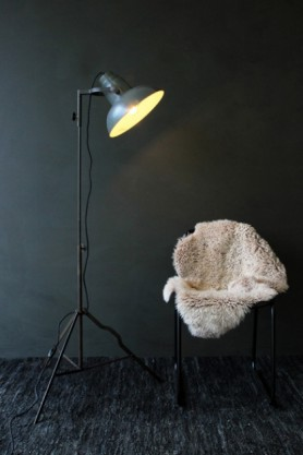 Industrial Film Floor Lamp With Grey Shade sheepskin on chair with dark background lifestyle image