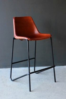 lifestyle image of Industrial Leather Bar Stool - Brown on grey flooring and dark grey wall background