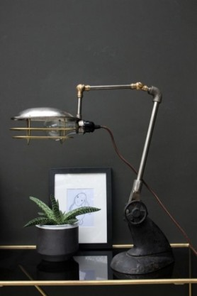 Industrial-Style Task Light on desk with dark background lifestyle image
