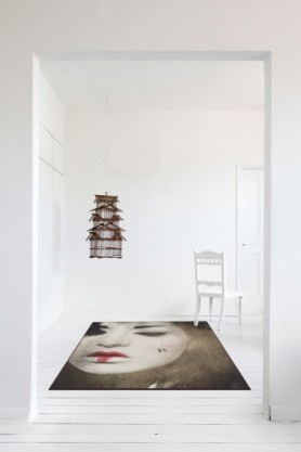 lifestyle image of Japanese Repose Rug with hanging wooden bird cage in completely white room