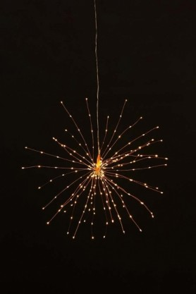 lifestyle image of Large Pretty Wire Starburst Light Copper with black wall background