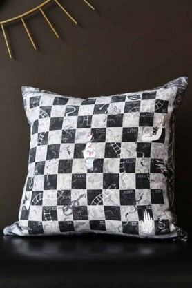 Lifestyle image of the Limited Edition Snakes & Ladders Cushion